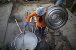 Efraina Rivera stirs a vat of oatmeal at a