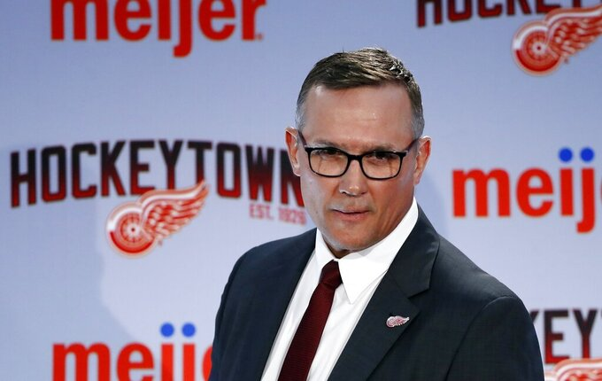 FILE - In this April 19, 2019, file photo, Steve Yzerman walks into the news conference where he was introduced as the new executive vice president and general manager of the Detroit Red Wings NHL hockey club in Detroit. The Red Wings could actually benefit from an adjusted draft lottery that gives him better odds at the top pick, likely Alexis Lafreniere. (AP Photo/Carlos Osorio, File)