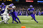Minnesota Vikings running back Dalvin Cook (33) carries near the goal line in the first half of an NFL wild-card playoff football game against the New Orleans Saints, Sunday, Jan. 5, 2020, in New Orleans. (AP Photo/Butch Dill)