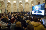 The crowd applaudes as U.N. court's conviction and sentencing of ex-Bosnian Serb leader Radovan Karadzic is broadcasted in the city hall in Sarajevo, Bosnia-Herzegovina, Wednesday, March 20, 2019. United Nations appeals judges have upheld the convictions of former Bosnian Serb leader Radovan Karadzic for genocide, war crimes and crimes against humanity and increased his sentence from 40 years to life imprisonment. (AP Photo/Darko Bandic)