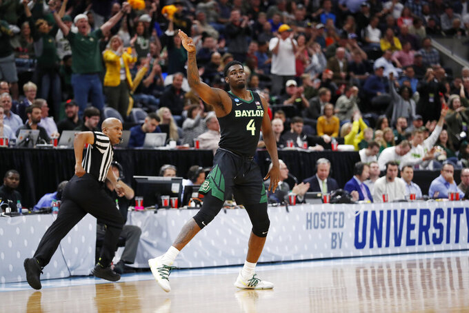 Baylor guard Mario Kegler (4) reacts to a 3-pointer during the first half against Syracuse in a first-round game in the NCAA men's college basketball tournament Thursday, March 21, 2019, in Salt Lake City. (AP Photo/Jeff Swinger)