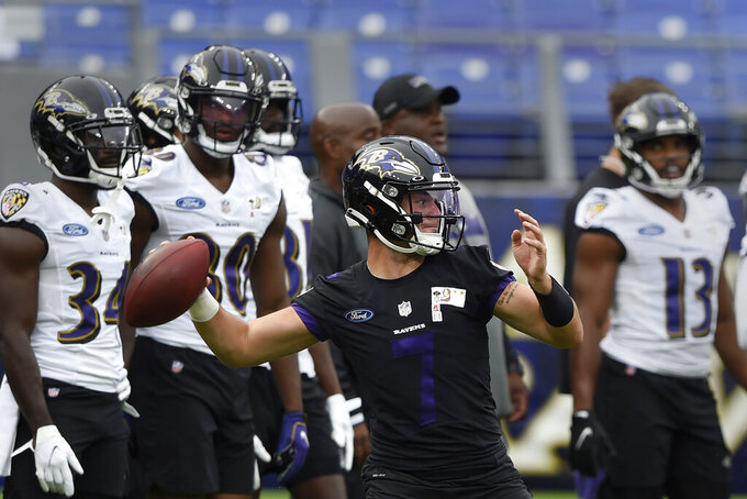 Baltimore Ravens quarterback Trace McSorley throws during NFL football training camp Saturday, July 31, 2021, in Baltimore. (AP Photo/Gail Burton)