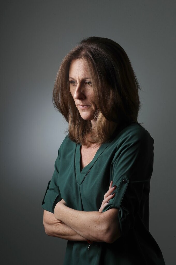 "Kim Goldman poses for a portrait Friday, June 7, 2019, in Los Angeles. Goldman has continued to make the case publicly that it was O.J. Simpson who killed her brother and Simpson's ex-wife on a June night in 1994. Beginning Wednesday, Goldman will examine the case in a 10-episode podcast, ""Confronting: OJ Simpson."" She'll interview her brother's old friends, the police detective who investigated the killings, attorneys for the defense and prosecution, and two of the 12 jurors who voted to acquit Simpson. (AP Photo/Marcio Jose Sanchez)"