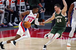 Detroit Pistons guard Josh Jackson (20) drives on Milwaukee Bucks guard Pat Connaughton (24) during the first half of an NBA basketball game, Wednesday, Jan. 13, 2021, in Detroit. (AP Photo/Carlos Osorio)