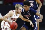 Boston College's Rich Kelly, left, drives past Virginia's Reece Beekman, right, during the first half of an NCAA college basketball game, Saturday, Jan. 9, 2021, in Boston. (AP Photo/Michael Dwyer)
