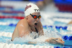 FILE - Lilly King competes in a women's 200-meter breaststroke semifinal during wave 2 of the U.S. Olympic Swim Trials in Omaha, Neb., in this Thursday, June 17, 2021, file photo. King stirred up the already heated rivalry with the Australians by making a bold prediction for the U.S. women at the Tokyo Aquatics Center. (AP Photo/Charlie Neibergall, File)