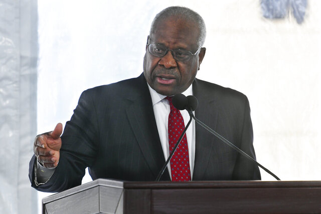 Supreme Court Justice Clarence Thomas delivers a keynote speech during a dedication of Georgia new Nathan Deal Judicial Center Tuesday, Feb. 11, 2020, in Atlanta. The center is named for a former governor and is the first state building in the history of Georgia that is devoted entirely to the judiciary. (AP Photo/John Amis)