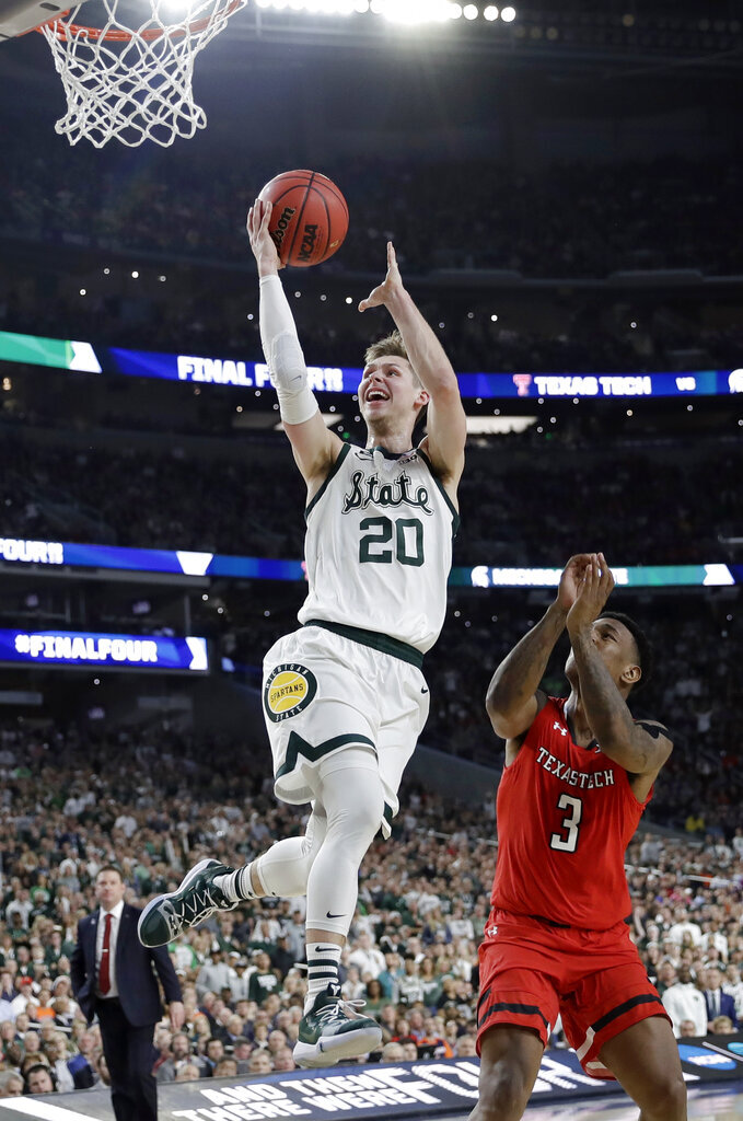 Michigan State guard Matt McQuaid (20) drives to the basket over Texas Tech forward Deshawn Corprew (3) during the first half in the semifinals of the Final Four NCAA college basketball tournament, Saturday, April 6, 2019, in Minneapolis. (AP Photo/David J. Phillip)