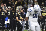 New Orleans Saints quarterback Drew Brees (9) celebrates for a touchdown pass that was called back for offensive pass interference in the first half of an NFL football game against the Indianapolis Colts in New Orleans, Monday, Dec. 16, 2019. The pass, had it counted, would have given Brees the NFL record for career touchdown passes, which he tied Peyton Manning for earlier in the game. (AP Photo/Bill Feig)