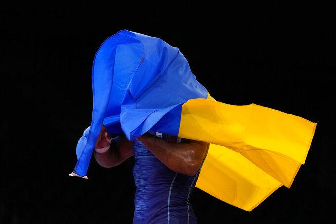 Ukraine's Zhan Beleniuk celebrates defeating Hungary's Viktor Lorincz during the men's 87kg Greco-Roman wrestling final match at the 2020 Summer Olympics, Wednesday, Aug. 4, 2021, in Chiba, Japan. (AP Photo/Aaron Favila)