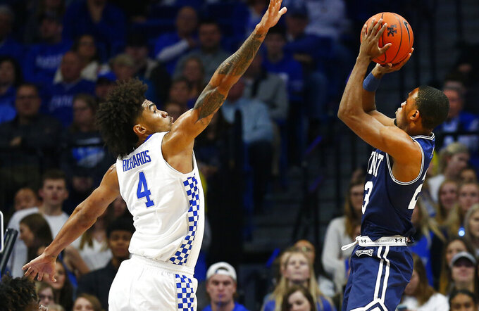 Mount St. Mary's Brandon Leftwich, right, shoots while defended by Kentucky's Nick Richards (4) during the first half of an NCAA college basketball game in Lexington, Ky., Friday, Nov. 22, 2019. (AP Photo/James Crisp)