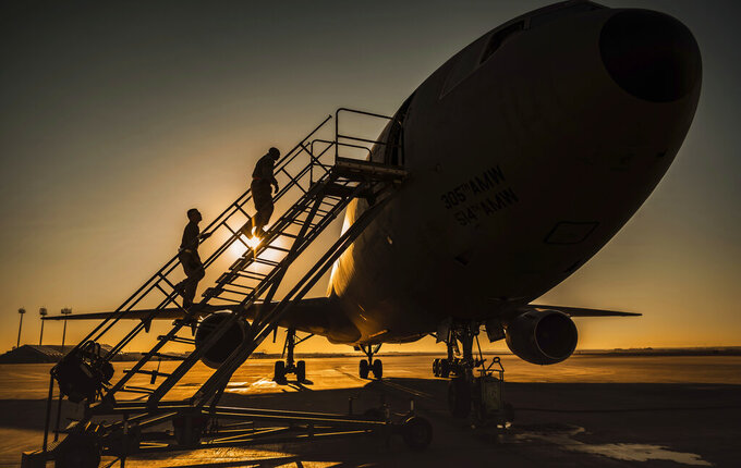 "In this Jan. 5, 2021 photo from the U.S. Air Force, two KC-10 Extender crew chiefs board the aircraft at Al-Dhafra Air Base, United Arab Emirates. An Air Force KC-10 Extender that flew out of Al-Dhafra Air Base in the United Arab Emirates on Sunday, May 2, 2021, used the call sign ""PIKLRICK"" on a mission that saw it fly east out over the Gulf of Oman, according to flight-tracking data. The call sign appears to be a nod to an episode of the cartoon ""Rick and Morty"" in which one of the titular characters turns himself into a pickle to escape a family therapy session. (U.S. Air Force/Staff Sgt. Trevor T. McBride, via AP)"