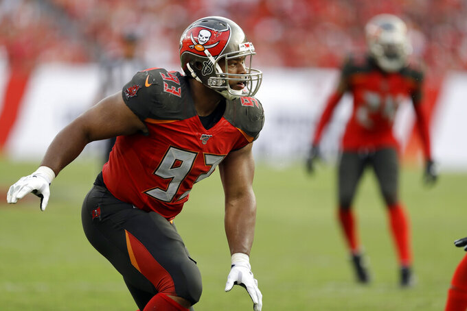 Tampa Bay Buccaneers nose tackle Ndamukong Suh (93) works against San Francisco 49ers during the second half an NFL football game, Sunday, Sept. 8, 2019, in Tampa, Fla. (AP Photo/Chris O'Meara)
