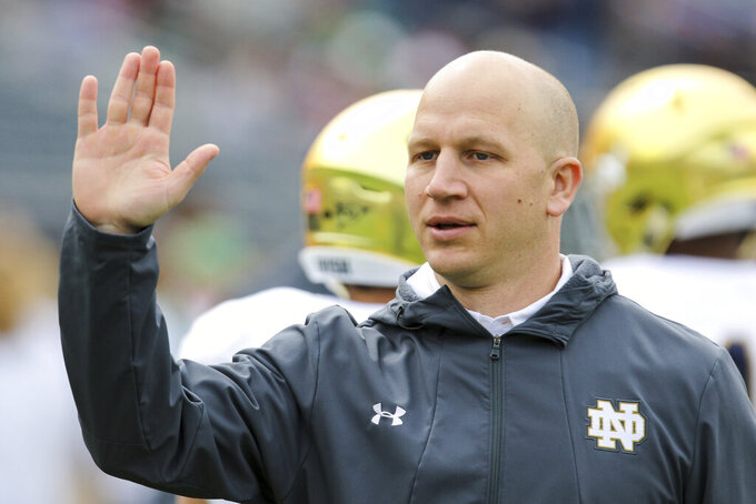 Notre Dame defensive coordinator Clark Lea greets players during warmups before Saturday's Blue-Gold Game at Notre Dame in South Bend, Ind., in this April 13, 2019, photo. Vanderbilt is negotiating a deal with Notre Dame defensive coordinator Clark Lea to make the former Commodores player its new head coach. Two people with knowledge of the situation told The Associated Press details of a contract were still being worked out but Lea was the school's top choice.  (Robert Franklin/South Bend Tribune via AP)