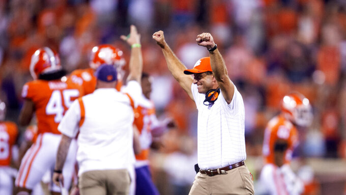 Clemson head coach Dabo Swinney raises both hands in victory during the second half of an NCAA college football game against Boston College Saturday, Oct. 2, 2021, in Clemson, S.C. (AP Photo/Hakim Wright Sr.)