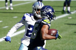 Seattle Seahawks wide receiver Tyler Lockett comes down with a pass reception for a touchdown in front of Dallas Cowboys cornerback Trevon Diggs during the first half of an NFL football game, Sunday, Sept. 27, 2020, in Seattle. (AP Photo/Elaine Thompson)