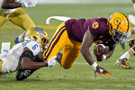 Arizona State wide receiver Jordan Kerley is tackled by UCLA defensive back John Humphrey (6) during the first half of an NCAA college football game Saturday, Dec. 5, 2020, in Tempe, Ariz. (AP Photo/Matt York)