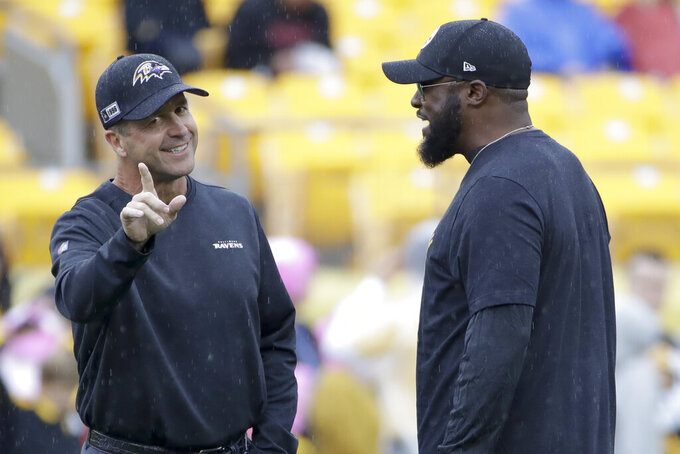 Pittsburgh Steelers head coach Mike Tomlin, right, and Baltimore Ravens head coach John Harbaugh talk before an NFL football game Sunday, Oct. 6, 2019, in Pittsburgh. (AP Photo/Don Wright)