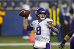 Minnesota Vikings quarterback Kirk Cousins passes against the Seattle Seahawks during the first half of an NFL football game, Sunday, Oct. 11, 2020, in Seattle. (AP Photo/Ted S. Warren)