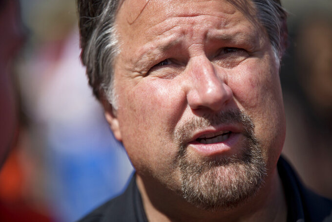 "FILE - In this April 2, 2015, file photo, car owner Michael Andretti speaks to a reporter during a news conference in Philadelphia. Andretti Autosport and Chip Ganassi Racing are the first two American teams to commit to a new electric SUV off-road racing series scheduled to begin in 2021.  The Extreme E series has five events planned in what the league is calling ""some of the most remarkable, remote and severely damaged locations on the planet."" ""The current COVID-19 crisis is bringing attention to a changing world, and our traditional mindsets have to adapt with that,"" said team owner Michael Andretti. (AP Photo/Matt Rourke, File)"
