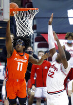 Illinois guard Ayo Dosunmu, left, goes up to shoot against Ohio State forward E.J. Liddell during the first half of an NCAA college basketball game in Columbus, Ohio, Saturday, March 6, 2021. (AP Photo/Paul Vernon)
