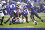 Kentucky quarterback Lynn Bowden Jr. (1) runs for a touchdown during the first half of the NCAA college football game against Louisville, Saturday, Nov. 30, 2019, in Lexington, Ky. (AP Photo/Bryan Woolston)