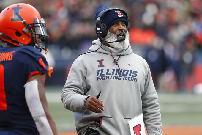 Illinois head coach Lovie Smith looks up at the scoreboard during the second half of an NCAA college football game against Rutgers Saturday, Nov. 2, 2019, in Champaign, Ill. (AP Photo/Charles Rex Arbogast)