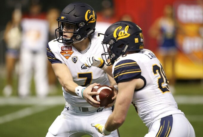 California quarterback Chase Garbers (7) hands the ball off to running back Patrick Laird (28) during the first half of the Cheez-It Bowl NCAA college football game against TCU on Wednesday, Dec. 26, 2018, in Phoenix. (AP Photo/Ross D. Franklin)