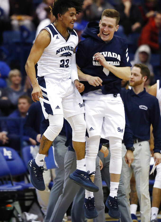 Nevada guard Jazz Johnson, left, celebrates his basket with guard David Cunningham during the second half of an NCAA college basketball game against Air Force on Tuesday, March 5, 2019, at Air Force Academy, Colo. Nevada won 90-79. (AP Photo/David Zalubowski)