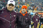 Virginia Tech head coach Justin Fuente and defensive coordinator Bud Foster take the field after shutting out Pittsburgh 28-0 after an NCAA college football game in Blacksburg, Va., Saturday, Nov. 23, 2019. (AP Photo/Matt Bell)