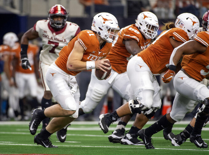 Texas quarterback Sam Ehlinger runs upfield against Oklahoma during the first half of the Big 12 Conference championship NCAA college football game on Saturday, Dec. 1, 2018, in Arlington, Texas. (AP Photo/Jeffrey McWhorter)