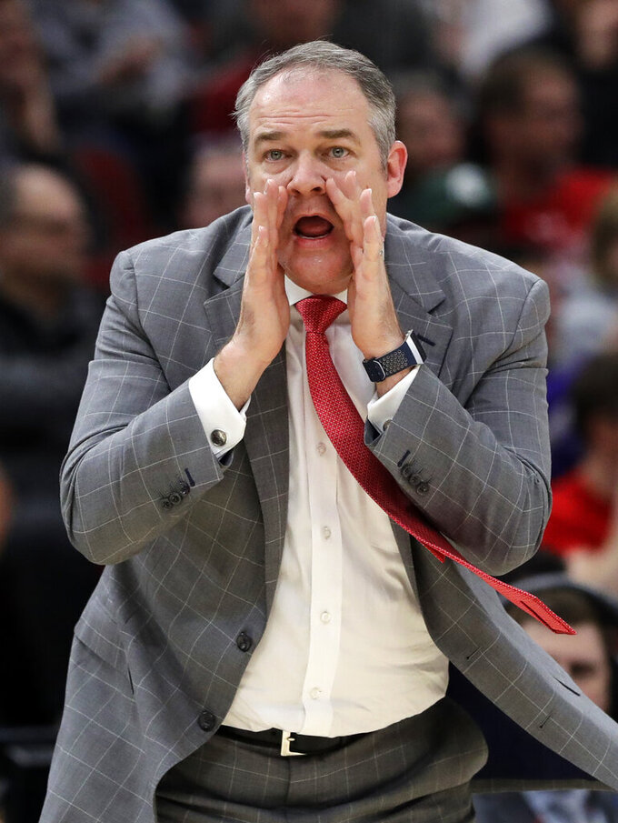 Rutgers head coach Steve Pikiell calls his team during the first half of an NCAA college basketball game in the first round of the Big Ten Conference tournament against Nebraska in Chicago, Wednesday, March 13, 2019. (AP Photo/Nam Y. Huh)