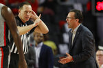 Georgia coach Tom Crean questions an official during the team's NCAA college basketball game against South Carolina on Wednesday, Feb. 12, 2020, in Athens, Ga. (Joshua L. Jones/Athens Banner-Herald via AP)