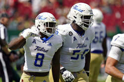 Tulsa running back Deneric Prince (8) celebrates his touchdown against South Florida with offensive lineman Tyler Smith during the first half of an NCAA college football game Saturday, Oct. 16, 2021, in Tampa, Fla. (AP Photo/Chris O'Meara)