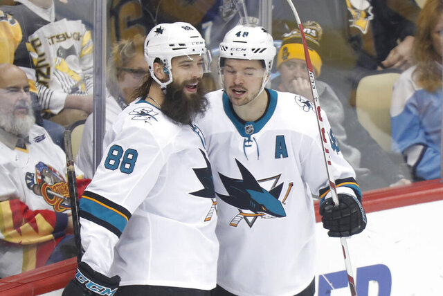 San Jose Sharks' Tomas Hertl, right, celebrates with Brent Burns (88) after scoring against the Pittsburgh Penguins during the first period of an NHL hockey game Thursday, Jan. 2, 2020, in Pittsburgh. (AP Photo/Keith Srakocic)