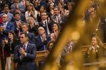 Spain's Prime Minister Pedro Sanchez, bottom left, applauds Spain's King Felipe VI, not seen, during the official opening of the parliamentary season in Madrid, Monday, Feb. 2, 2020. Nearly 50 lawmakers who advocate for the Spanish regions to become independent have boycotted Monday's ceremonial opening of the nation's legislative season over the presence of the royal family. The representatives of five parties from the Catalonia, Basque Country and Galicia regions, all in northern Spain, say the king's figure is