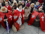 "In this Oct. 5, 2019, photo, Polish Catholics pray at an anti-gay event in Warsaw, Poland. About 200 people marched holding rosaries and crucifixes and praying to apologize for what they say is the ""desecration"" of pride parades. (AP Photo/Czarek Sokolowski)"