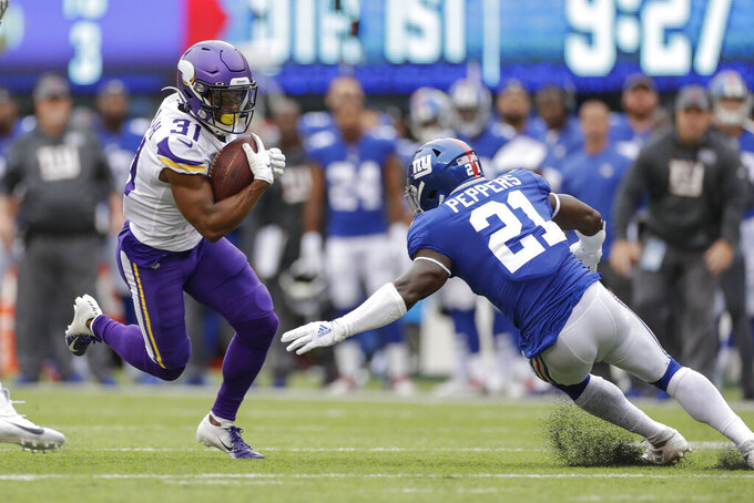 Minnesota Vikings running back Ameer Abdullah (31) attempts to avoid a tackle by New York Giants free safety Jabrill Peppers (21) during the first quarter of an NFL football game, Sunday, Oct. 6, 2019, in East Rutherford, N.J. (AP Photo/Adam Hunger)