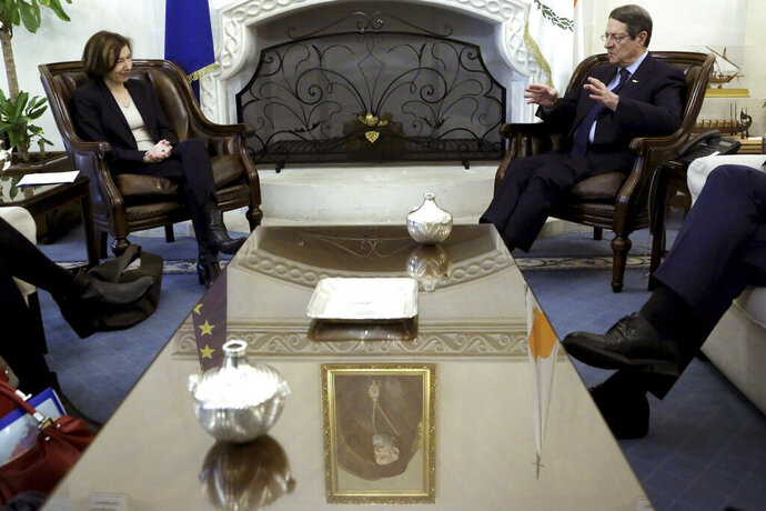 France's Defense Minister Florence Parly, left, talks with Cyprus' President Nicos Anastasiades during their meeting at the Presidential palace in capital Nicosia, Cyprus, Tuesday, Feb. 18, 2020. Parly said on Tuesday that her country stands in solidarity with Cyprus amid tensions over a Turkish search for natural gas inside Cypriot waters. (AP Photo/Petros Karadjias)