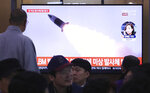 People watch a TV showing a file image of North Korea's missile launch during a news program at the Seoul Railway Station in Seoul, South Korea, Thursday, Oct. 31, 2019. South Korea's military said North Korea on Thursday fired two projectiles toward its eastern sea, an apparent resumption of weapons tests aimed at ramping up pressure on Washington over a stalemate in nuclear negotiations. The sign reads: