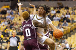Missouri's Dru Smith, right, passes the ball around Texas A&M's Jay Jay Chandler, left, during the second half of an NCAA college basketball game Tuesday, Jan. 21, 2020, in Columbia, Mo. Texas A&M won the game 66-64. (AP Photo/L.G. Patterson)