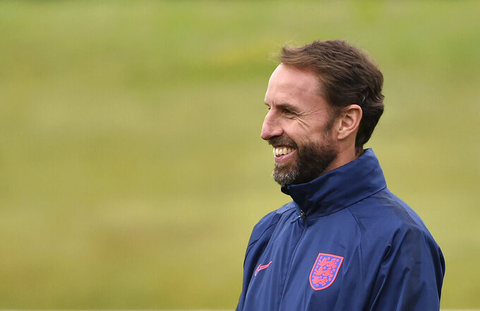 England's manager Gareth Southgate smiles during a training session at St George's Park, Burton upon Trent, England, Monday June 28, 2021, ahead of their Euro 2020 soccer match round of 16 against Germany at Wembley Stadium on Tuesday. (AP Photo/Rui Vieira)