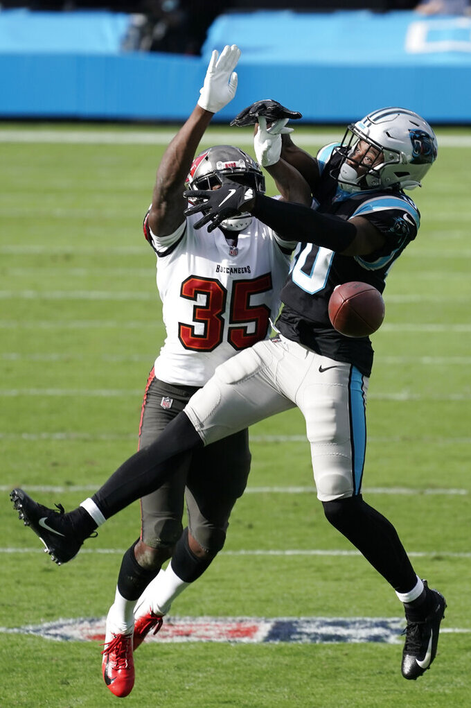 Tampa Bay Buccaneers cornerback Jamel Dean (35) breaks up a pass intended for Carolina Panthers wide receiver Curtis Samuel (10) during the first half of an NFL football game, Sunday, Nov. 15, 2020, in Charlotte , N.C. (AP Photo/Gerry Broome)