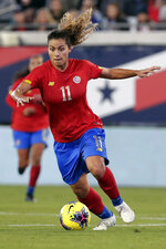 FILE - In this Nov. 10, 2019, file photo, Costa Rica midfielder Raquel Rodriguez (11) moves the ball during the second half of an international friendly soccer match against the United States, in Jacksonville, Fla. Raquel Rodriguez, better known as Rocky to her fans, was in route to join her new National Women's Soccer League team when sports were shut down by the coronavirus.  It certainly wasn't an ideal start for the Costa Rican striker with the Portland Thorns. (AP Photo/John Raoux, File)