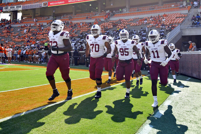 South Carolina State arrives for warm ups before an NCAA college football game against Clemson, Saturday, Sept. 11, 2021, in Clemson, S.C. (AP Photo/Edward M. Pio Roda)