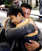David Xol-Cholom, of Guatemala hugs his son Byron at Los Angeles International Airport as they reunite after being separated about one and half year ago during the Trump administration's wide-scale separation of immigrant families, Wednesday, Jan. 22, 2020, in Los Angeles. (AP Photo/Ringo H.W. Chiu)