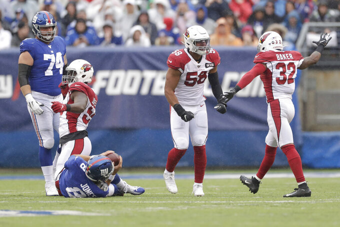 Arizona Cardinals' Jordan Hicks (58), second from right, and Budda Baker, right, celebrate a sack during the first half of an NFL football game against the New York Giants, Sunday, Oct. 20, 2019, in East Rutherford, N.J. (AP Photo/Adam Hunger)