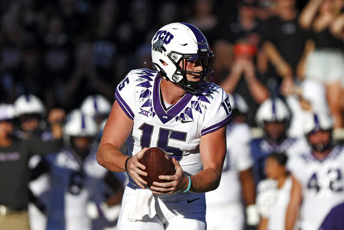 TCU's Max Duggan (15) catches the snapped ball during the first half of an NCAA college football game against Texas Tech, Saturday, Oct. 9, 2021, in Lubbock, Texas. (AP Photo/Brad Tollefson)