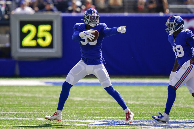 New York Giants linebacker Lorenzo Carter celebrates after recovering a fumble by Atlanta Falcons running back Mike Davis during the first half of an NFL football game, Sunday, Sept. 26, 2021, in East Rutherford, N.J. (AP Photo/Seth Wenig)