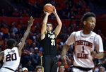 """FILE - In this Feb. 22, 2018, file photo, Purdue guard Dakota Mathias (31) shoots against Illinois guard Da'Monte Williams (20) during the second half of an NCAA college basketball game in Champaign, Ill. Mathias has developed a real affinity for old-school basketball. Over the last four seasons he mastered Matt Painter's traditional inside-out offense, adopted the program's """"play hard"""" moto and developed a personal proclivity for digging in on defense. Now, he and three other senior starters hope to show NCAA Tournament fans basic fundamentals and experience still matter in a sport that seems to be trending in the opposite direction.(AP Photo/Stephen Haas, File)"""